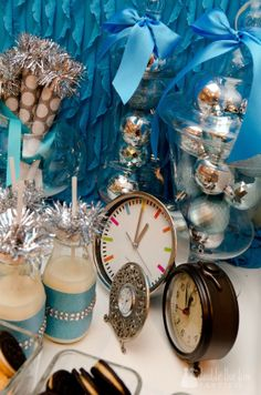 Love the garland and polka dots on the blowers. The adorable milk and cookies, the clocks...the big blue bows...