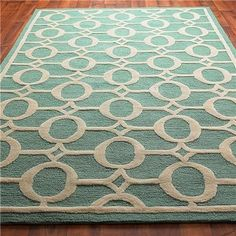 Indoor/Outdoor Carved Ellipse Rug, Crisp Aqua and Cream - $279» Bring this outdoor rug inside and try it in your nursery. The texture is soft, but because it's so washable, you know it will stand up to any accidents your baby may have.