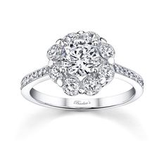 Flower Engagement Ring - 7661LW - Stunning, in vogue, this white gold diamond halo engagement ring will capture the eye of many admirers.  Shared prong set diamonds encircle the low profile round diamond center and pave set diamonds cascade down the dainty shank for a look of  sheer elegance.    Also available in 18k and Platinum.