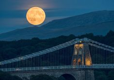 This evening's 'super/blood/harvest/full moon' rising over the Menai Suspension Bridge. If anyone is planning to catch the lunar eclipse later tomorrow morning in the early hours, then I hope you all get clear skies and good luck :-)  Single exposure taken on Olympus E-M5 Mk2, at 300mm. Not a composite image.
