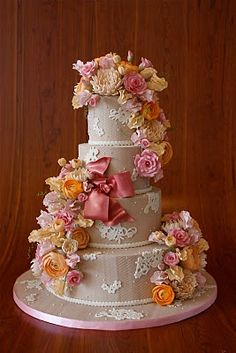 Orange and pink flowers with lace cake.