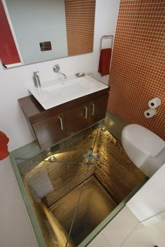 Bathroom with glass floor, overlooking a 15 story elevator shaft.