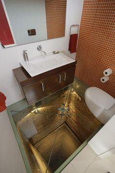 Bathroom with glass floor, overlooking a 15 story elevator shaft.
