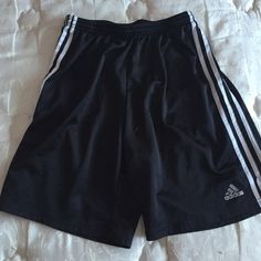 Men's black adidas shorts Black adidas shorts, in GREAT condition selling some stuff for my brother. If you have any questions or concerns feel free to leave a comment below and I'll do my best to get back to you Adidas Pants