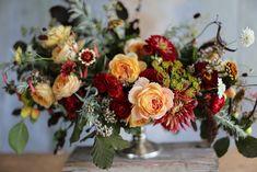 Floret summer centerpiece  copper beech, crabapples, dahlias, garden roses, artemesia, oregano, zinnias, cape fuchsia, beans, millet, dill, scabiosa,