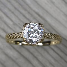 NO CONFLICT   Round Forever Brilliant™ Moissanite Feather Engagement Ring, Carved Floral Setting (1ct)
