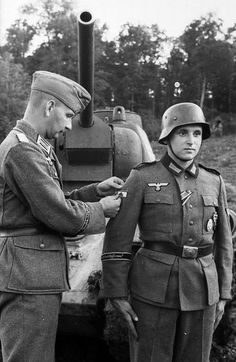 Receiving the Tank Destruction Badge - Given to soldiers who destroyed a tank single handedly with a hand held weapon.