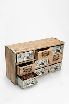 Reclaimed Card Catalog Organizer Cabinet  #UrbanOutfitters $79? Moohahaha! I have the real thing in storage from a library auction, and it is cooler than this. I feel a little better now after drooling over the furniture on this website. Still, if I didn't have that, I'd probably settle for this!