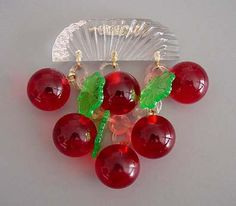 Bakelite transparent red cherries brooch with Lucite top and green plastic leaves