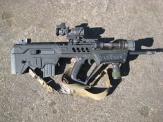 The IWI TAR-21 Tavor Bullpup Rifle. Makes an excellent compact defensive stance road weapon.