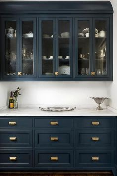 Navy cabinets look amazing with brass hardware and white carerra marble countertops, no doubt! But will they look dated years from now?Navy cabinets l Navy Kitchen Cabinets, Blue Cabinets, Painting Kitchen Cabinets, Pantry Cabinets, Upper Cabinets, Kitchen Paint, Glass Cabinets, Colorful Kitchen Cabinets, Pantry Doors