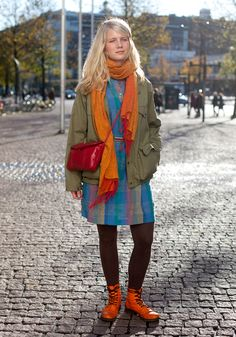 """Lotten, 21 """"I like things that stand out like my orange boots. I also like experimenting with colours and colour combinations. I've given myself a promise not to buy new clothes from July til January."""" 20 October 2011"""