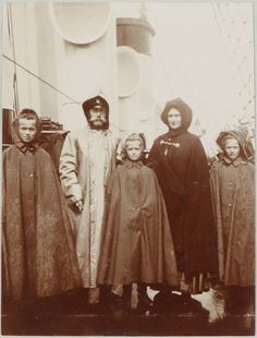 Romanov Collection of Family Albums  Emperor, Empress in rain gear with three daughters.