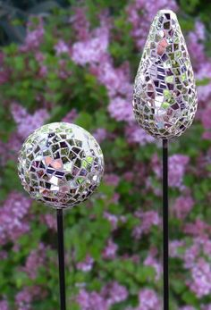 Mirrored Mosaic Garden Stakes. Mirror glass is grouted to resin ball and attached to a long wrought iron stake.