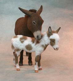 """A pair of 1:12 burros or donkeys by miniature animal artist Kerri Pajutee."