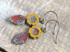 Rustic Fall Leaf Earrings. Autumn Leaf Earrings. Red & Yellow Czech Glass Beads. Autumn Leaves, Woodland, Nature Jewelry.- -These Autumn inspired earrings feature Czech glass carved leaf beads in a vibrant shade of red with an earthy olive Picasso wash.  Wire wrapped above are deep mustard yellow Czech glass pansy flower beads, which have a rustic finish around the edges and in their carved centre.  The earrings have round Vintaj brass earwires and measure about 5cms in total.