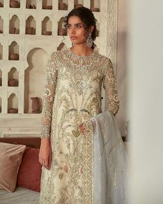 """SUFFUSE on Instagram: """"Selene! PKR 145,000  This ivory shirt redefines elegance and stands out to be an embodiment of a gorgeous interlay of pearl encrusted hand…"""" Pakistani Couture, Pakistani Bridal, Straight Trousers, Pakistani Designers, Bridal Collection, Beautiful Dresses, Ivory, Elegant, Pearl"""