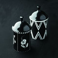Porcelain powder jars designed by Dagobert Peche, 1912. Hand-painted glazed bone china in black and white, one in a geometric and one in a botanical design