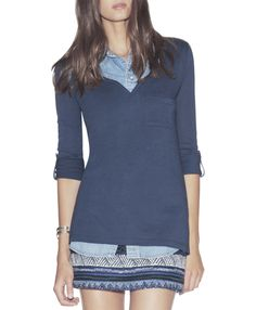 layer a henley over your denim top, and add a patterned mini skirt