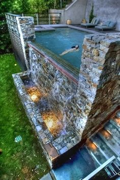 Pool with waterfall and lights, Beautiful Backyard