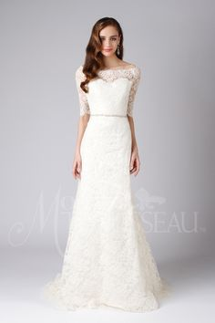Classic off the shoulder French lace gown with a fitted bodice and A-line skirt edged in lace.
