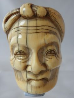 Ivory mask netsuke with old man Jo, signed Meikeisai Hojitsu. Super ivory mask netsuke from the Noh plays, These Jo masks known by the Hair tied up and the age in the face. Nice mellow patina and signed on the back Meikeisai Hojitsu. Size 35mm high - 27mm wide. Late 18th early 19th C