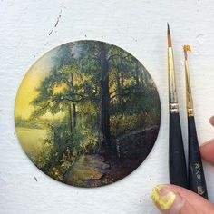 Beautiful #nature #painting by Dina Brodsky (@dinabrodsky) depicting an overlook point at the edge of a forest near sunset. I'm not certain whether we are looking out onto on a lake or if we are higher in elevation than the land below and can see the expanse of a great field beyond the dense vegetation but Dina's illustrative skills in depicting light and shadow and the spaces in between are quite magnificent.  I love the vibrant golden yellows of the sky tinged with hints of orange around…