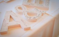 Super cute #guestbook alternative using oversized wooden letters of the bride and groom's first names! Or just a big giant H for us both.