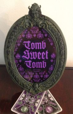 Disney Haunted Mansion Tomb Sweet Tomb 5 x 7 Picture Photo Frame. Very ornate frame done up in Haunted Mansion style. Comes with two Madam Leota Taro cards as shown.