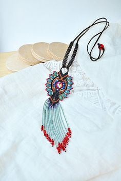 Bohemian necklace, fringe micro-macrame necklace, tribal, boho chic, free spirit, macrame jewelry, dangle tassel, beadwork, brown red orange ____  ❧ This is a beaded micro-macrame necklace. ❧ I used red, orange, dark brown, dim turquoise, purple colors. ❧ The necklace is long, dangle with fringe. ❧ Quality materials used. ❧ The original design. ❧ Bohemian / tribal / boho / free spirit style.  ❧ Materials used: - Czech glass beads, - Czech seed beads, - Miyuki Delica beads and l...