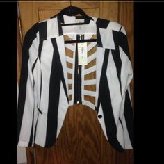 Cut back, black and white blazer Black and white blazer with a cut out back, very cute, never worn. Deciding to sell because I never wore it. Jackets & Coats Blazers