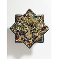 Tile Place of origin: Kashan, Iran (made) Date: ca. (made) Materials and Techniques: Fritware, moulded and painted in colours and lustre Credit Line: George Salting Bequest Museum number: Gallery location: World Ceramics, room case 47 Tile Art, Mosaic Art, Mosaic Tiles, Wall Tile, Islamic World, Islamic Art, Islamic Tiles, Blue Pigment, Ancient Persian