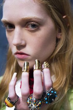 Rings from Gucci Spring Summer 2016 are encrusted with crystals and colorful beads.