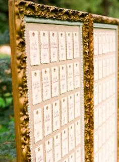 Escort Card Display Board. It might be a nice idea to ask Granny to watercolour name cards. something as simple as a mountain scape... maybe a different scene for each table and we can duplicate them and have them laminated... :)