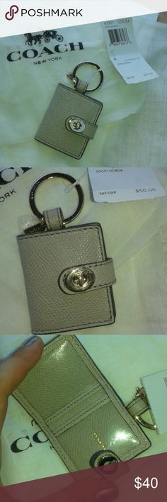 """Coach key fob Coach key fob opens up and holds two pictures, one on each side. Super cute!! Made of gray leather with gold lock and key chain. Attached is a gold Coach tag on the key ring. NWT never used. 1.5"""" x 2"""" Coach Accessories Key & Card Holders"""