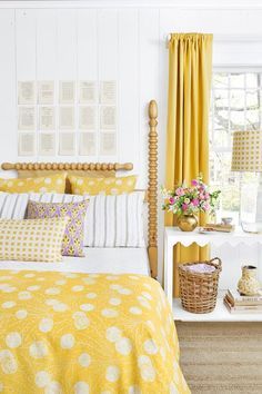 Bright yellow bedding and drapes in this white cottage bedroom give it pizzazz. Bright Bedding, Yellow Bedding, Yellow Bedrooms, Bedding Sets, Yellow Curtains, Yellow Room Decor, Yellow Bedroom Decorations, Deco Design, Design Design