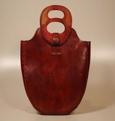 Karras leather, artisanal bags, the double handle and shape are interesting, unusual, and there is a sense that these will last and wear well
