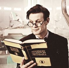 This is why Matt Smith is my favorite doctor. Look at his face! He's got an adorable smirk on his face while read Advanced Quantum Mechanics. What other doctor could pull that off without looking like a nerd, or without being Matt Smith?