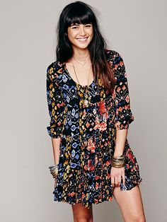Full Swing Dress at Free People. Love the cut and eclectic floral/ikat print. Such a pretty girl too.