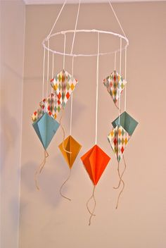 Super cute kite mobile. Would make a great DIY project!