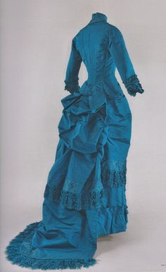 Afternoon dress, around 1880-1881, blue silk fringe trim, skirt with train. Musée d'Orsay exhibit, Impressionism and Fashion.