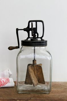 Antique butter churn with wooden paddles