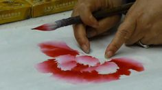 Loading a brush with water, different colors and ink is vitally important on drawing peony. Not only we use the tip of the brush but also we use the rest par...