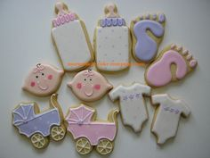 """Pink/Lilac Baby Girl Shower cookies - The theme of the shower was """"polka-dots"""", so I incorporated them in to the designs as much as I could. The baby face cookies are made from a lemon-shaped cookie cutter...I copied the idea from www.popcornpapa.com"""