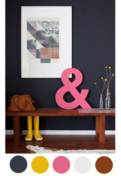 bench + bold art in entryway. navy, chestnut, yellow + pink color inspiration from With An I.E. by Ali Henrie