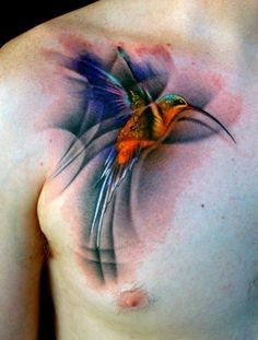 Vibrant multicolor hummingbird tattoo.