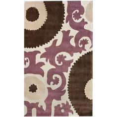 Hand-tufted rug with a tribal medallion motif.   Product: RugConstruction Material: PolypropyleneColor: Chocolate, purple and tanFeatures:  Made in TurkeyHand-tufted  Note: Please be aware that actual colors may vary from those shown on your screen. Accent rugs may also not show the entire pattern that the corresponding area rugs have.