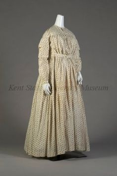 Circa 1865 Maternity day dress, ivory cotton with brown floral print.  Via Kent State University Museum.