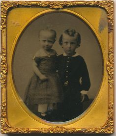 Antique Vintage Original 1/6 plate Ruby Ambrotype of Siblings posed together in a wonderful composition. Great affection shown between the two in this quality 19th century portrait. Not sure if the young child is a boy or girl? brother & sister? Lightly tinted Cheeks and Gold Buttons.  A very clean sixth plate Ruby Ambro in a lightly worn case. The spine is almost split but still slightly attached.  Follow me on Instagram @CrowCreekStudio & @CrowCreekUnique  My Etsy Shops  http:&...