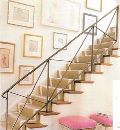 Hanging photos by stairs